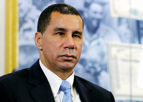 New York Gov. David Paterson will not to seek election amid a roiling scandal over  a woman who'd reported domestic violence against one of his top aides