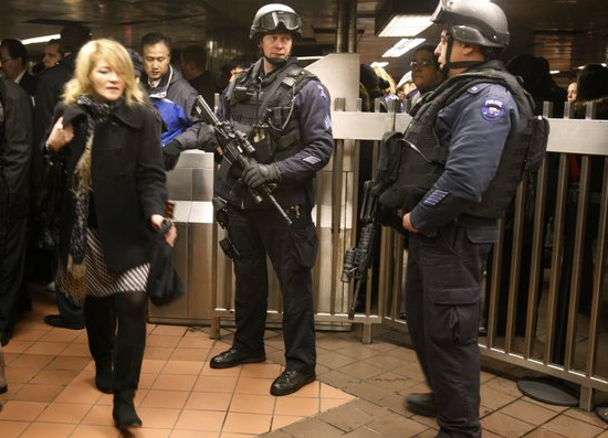 Bag searches and gun-toting police officers in the New York subway after Moscow bombs incident