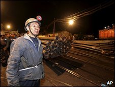 Rescue workers in northern China struggle to free 153 Miners