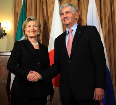 Canadian Foreign Minister Lawrence Cannon shakes hands with U.S. Secretary of State Hillary Clinton before a dinner for G8 Foreign Minister in Gatineau, Quebec, Canada, Monday March 29, 2010. (AP Photo/The Canadian Press, Fred Chartrand)