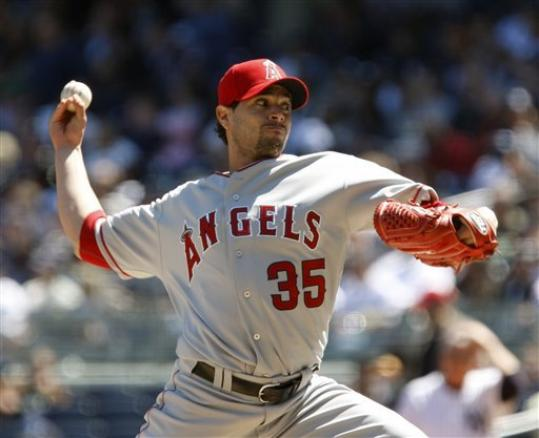 Joel Pineiro from Los Angeles Angels strains muscle before start against Red Sox