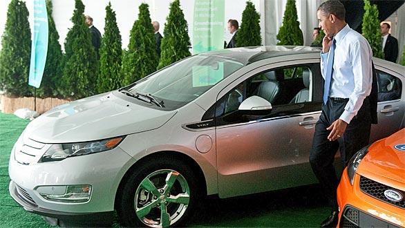 President Obama looks at a Chevy Volt following a groundbreaking ceremony at a battery factory in Holland, Michigan. (Saul Loeb / AFP/Getty Images)