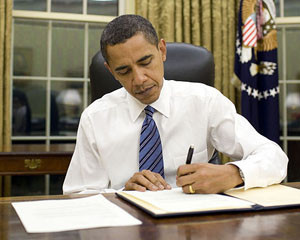 President Obama signed law that reduces or suspends tariffs paid by American companies