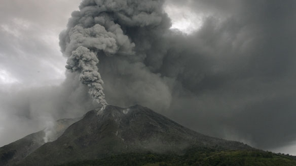 Mount Sinabung volcano spews smoke as seen from Bekerah village in the district of Tanah Karo in Indonesia's North Sumatra province on Monday. (Tarmizy Harva/Reuters)