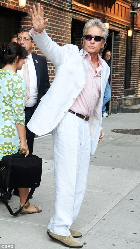 Tough guy: Michael Douglas arrives at the Manhattan studios of The Late Show with David Letterman last night.