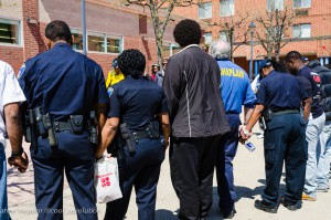 Baltimore police officers join a prayer circle led by a local church./Photo by Anne Meador